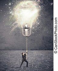 Illuminate an idea - Concept of illuminate an idea with a...