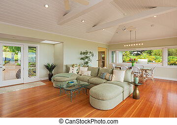 Living room in beautiful home with wood floors