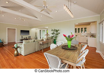 Living and dining room in beautiful home with wood floors