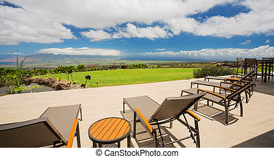 Patio with lounge chairs and view