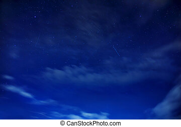 Star sky. Dark blue sky with light clouds and falling stars....