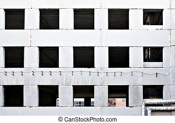 Wall of old destroyed factory house with broken windows...