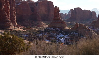 Arches National Park 04 - With bushes in the foreground, the...