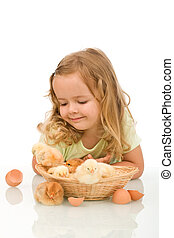 Little girl observing her little chicken babies - Little...