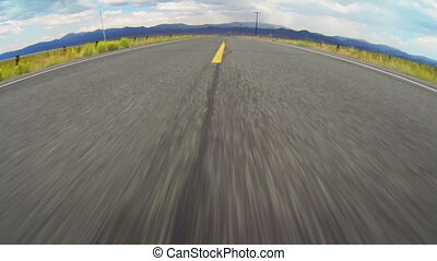 Driving Down Open Road - High speed vehicle point of view...