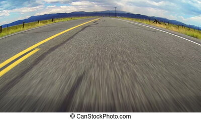 Speeding Down Open Road 60fps - High speed vehicle point of...