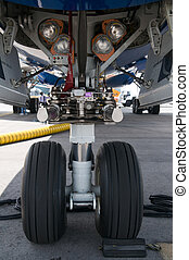 Nose wheel of airplane - Front landing gear of wide-body...