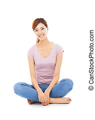 smiling beautiful asian young woman sitting on the floor