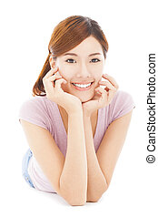 closeup of smiling young woman lying prone on the floor