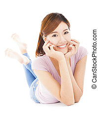 closeup of happy young woman lying prone on the floor