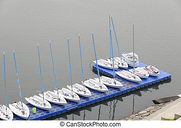 dinghy yachts in a row on the water in dock