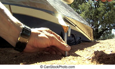 Hammering in Tent Pegs - Going camping in a tent and setting...