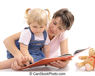 preschool - Young mother looking at books together with her...