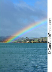 Rainbow in the sky and above the sea