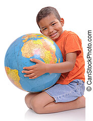child with globe - Child holding a globe on the white...