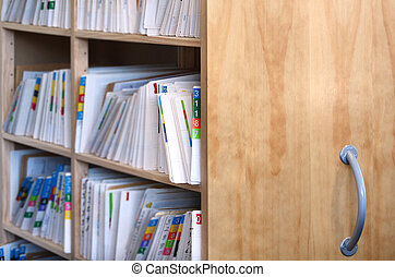 Medical record files on shelf of archive files cabinet...