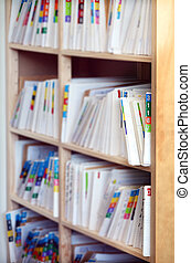Medical record files on shelf of archive files cabinet....