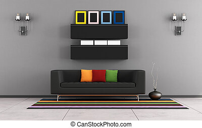 Contemporary living room with black couch on colorful carpet...
