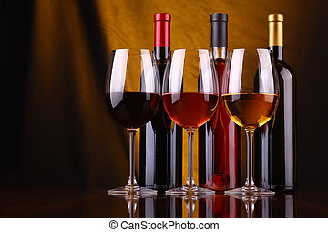 Wine glasses and bottles - Glasses and bottles of red, rose...
