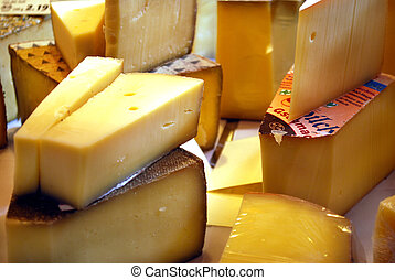 cheese - delicious cheese slices on market stall