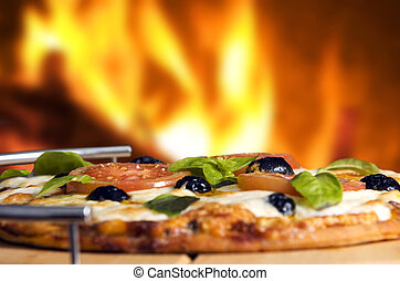 pizza - Oven baked pizza served on wooden board