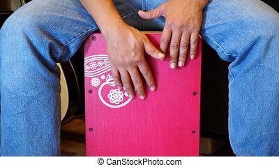 Man playing Pink cajon