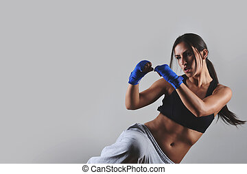 beautiful fitness woman - fitness woman with the blue boxing...