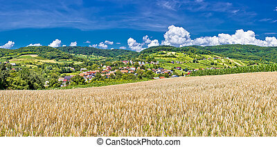 Idyllic agricultural landscape of Kalnik mountain, village...