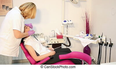 female dentist and patient in dental office