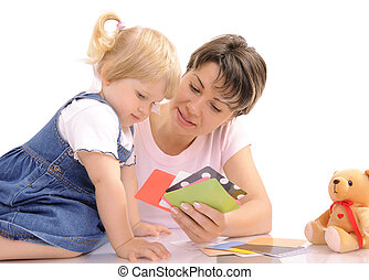 preschool - Young mother playing together with her little...