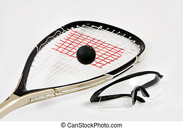 Squash racquet, ball and safety glasses - Closeup of a...