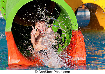 Boy at aqua park - Boy has into pool after going down water...