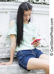 portrait of the asian girl with smartphone