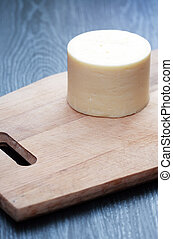 Cheese On Board - One truckle on wooden cutting board