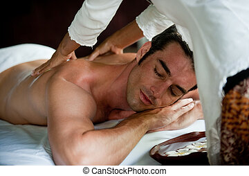Man Having Massage - A good-looking man getting a back...
