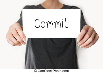 Commit. female showing card - Commit. Female in black shirt...