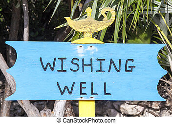 Wishing Well - The wishing well sign standing next to the...