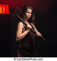 Maniac woman with ax - Girl with ax in hand on gray...