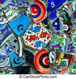 broken ceramics - sign Turkey and fish in mosaic of broken...