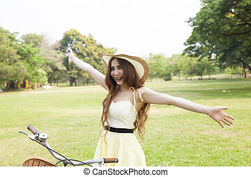 Public feeling refreshed and relaxed in the park. Woman...