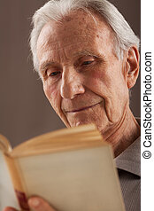 Elderly senior men reading - Elderly senior men sitting and...
