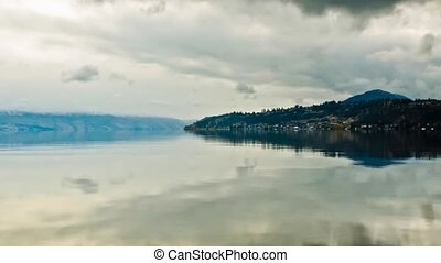 Overcast Clouds on Lake - Overcast sky on lake okanagan in...