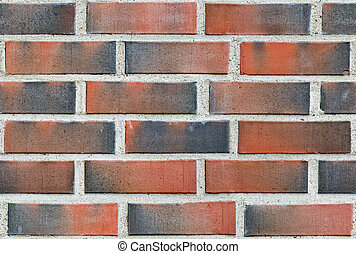 Burned red lining brick wall seamless background.