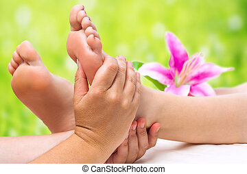 Hands doing foot massage - Close up of female therapist...