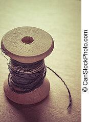Vintage wooden spool - Old vintage wooden spool with a fiber...