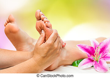 Spa therapist doing foot massage - Extreme close up of...