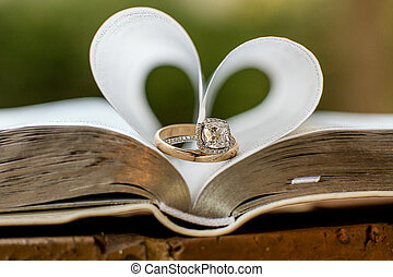 Wedding Rings - Wedding rings sitting on family bible with...