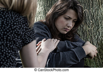 woman comforting her sad friend - Horizontal view of a woman...