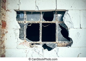 Lattice window - An old barred window with broken masonry