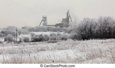 Coal mine in winter, Donbass. Donetsk region, Ukraine. Full...